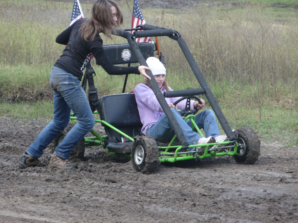 Patience pushes Alexis out of the mud.